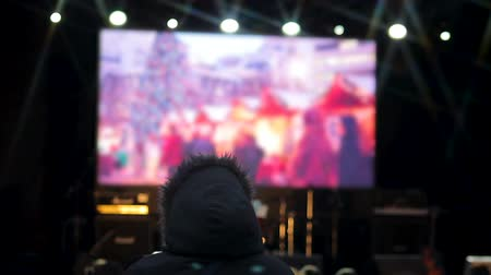 привет : People watching clips of upcoming celebration on big screen in central square