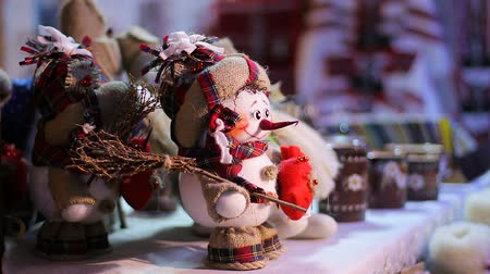 sněhulák : Little cute snowman standing on counter at toy shop, Christmas souvenirs