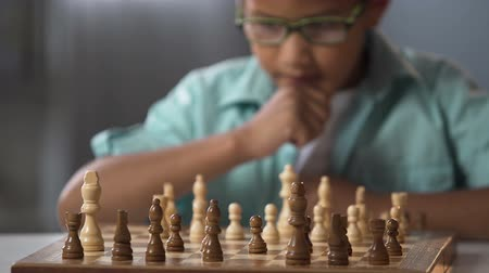 mastermind : Child going in circle on chess, development of logical thinking for children