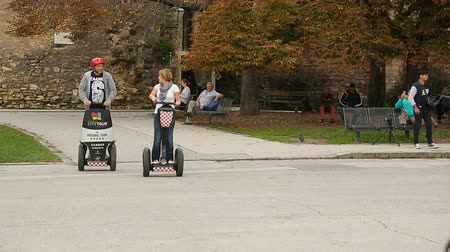 self balancing : Zagreb city tour on segways, people enjoying excursion, transport of future