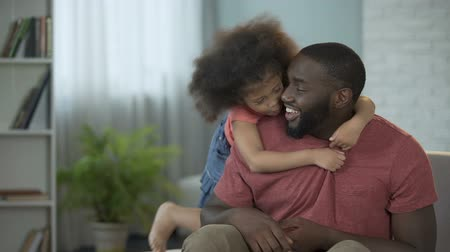 fondness : Happy daughter closing dads eyes with her little hands making him surprise Stock Footage