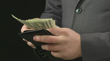 soma : Male boss getting money out of his wallet, counting and putting back. Rich man