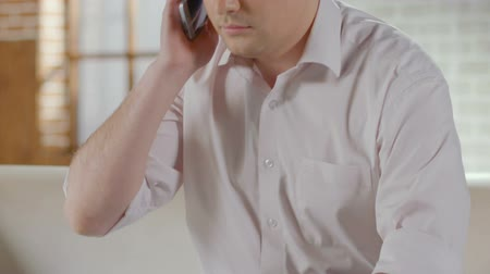 complaints : Guy talking over mobile phone and finishing call, making appointment, healthcare