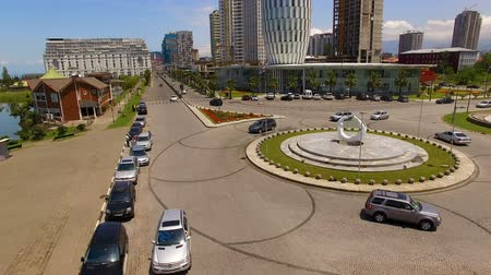 герои : Automobiles moving down roundabout crossroads on Heroes Square in Batumi Georgia