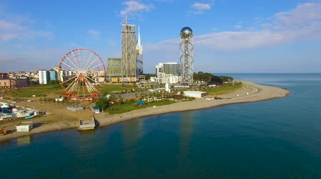 betűrendes : Batumi landmarks standing at seafront, Ferris wheel and Alphabetic Tower tourism