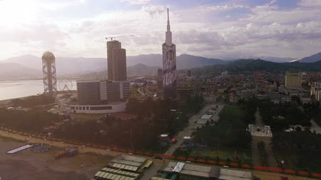 betűrendes : Batumi downtown in light haze against mountain skyline, early evening in city Stock mozgókép