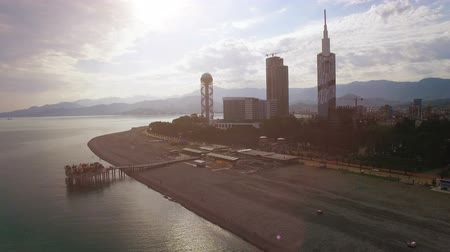 betűrendes : Light haze surrounding Batumi seafront with buildings at back, late afternoon Stock mozgókép