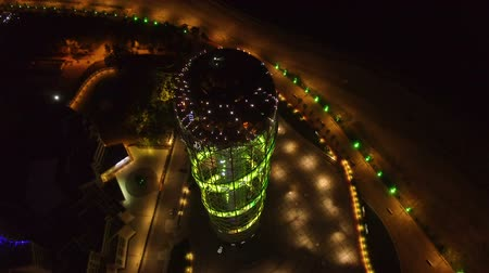betűrendes : Alphabetic tower in Batumi Georgia aerial view, nightlit city with cars running