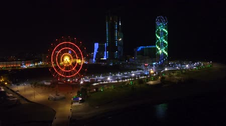 betűrendes : Stunning view of panoramic wheel and Alphabetic tower illumination at night
