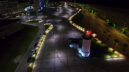 betűrendes : Peaceful empty boulevard with luminous lighthouse and tower shining bright