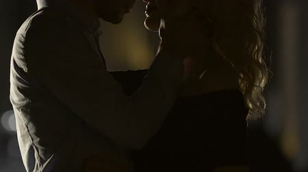 kafaları : Young male kissing pretty female at night, loving relationship tenderness, date Stok Video