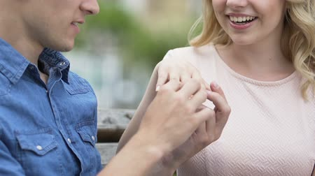 propor : Happy male putting wedding ring on the hand of his beloved, engagement Vídeos