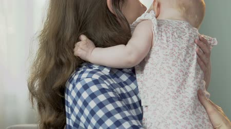 restless : Mother kissing and hugging small kid, comforting soothing movements, upset child