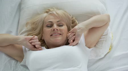 waking : Optimistic middle-aged woman waking up early in the morning, vitality and energy