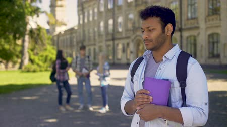 outsider : Biracial exchange student feeling lonely without friends at university abroad