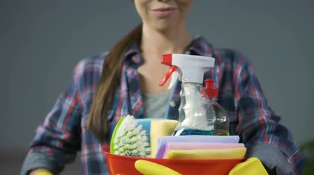 cleaning products : Satisfied housewife loves cleaning products, joyfully smiles into the camera