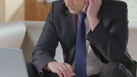compromise : Male in business suit dialing number on cell phone, starts talking, negotiations