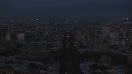 comutar : City at night, dark central street in Yerevan Armenia, air polluted by traffic