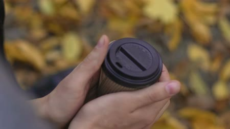 go away : Coffee cup in man hands, male feeling lonely and sad in the park, break up