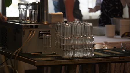 karczma : Stack of cleaned glasses on bar counter, catering service at company party