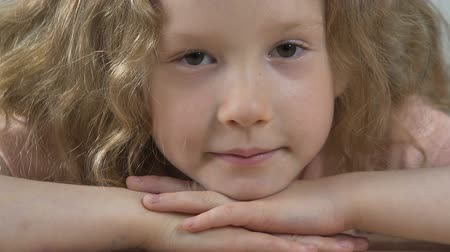 deep eyes : Beautiful little girl motionlessly staring into camera, deep and soulful look