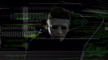 vulnerability : Unrecognizable man in white mask staring into camera, data codes background