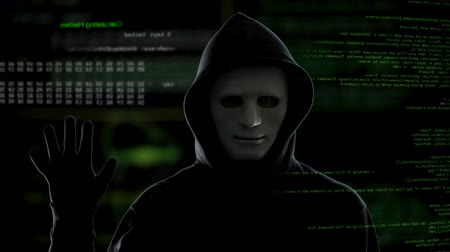 vulnerability : Dangerous male hacker on codes background stops hacking process, cyber crime Stock Footage