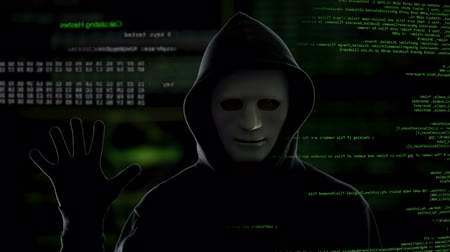 vulnerability : Male hacker on dark background start the hacking process, stealing information