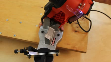 functionality : Specialist reviewing new lumber sawing machine, testing available functionality