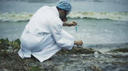 yöntem : Scientist performing toxic lake pollution test, sources of fresh water damaged Stok Video
