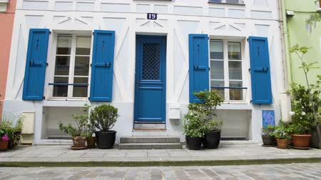 local : Beautiful colorful buildings placed on the Rue Cremieux street in Paris, France