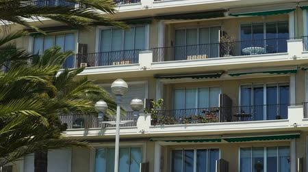markiza : House balconies with awnings swaying in wind, real estate in sunny resort city