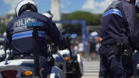 patrolman : Several municipal patrol policemen dismounting from motorbikes, public order Stock Footage