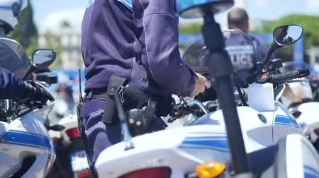 penas : Officer of motorbike police patrol on duty to maintain public order in big city