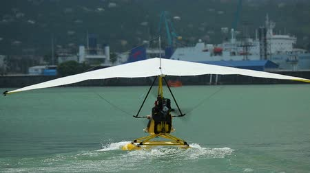 hang gliding : Water hang-glider taking off, active vacation, extreme sports in Batumi Georgia