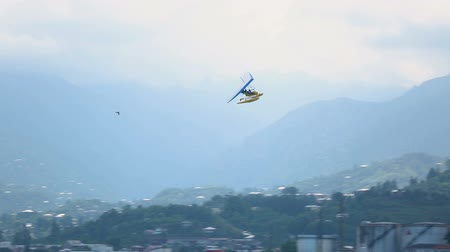 hang gliding : Hang-glider flying high in the sky and landing at seaside, active tourism, sport Stock Footage