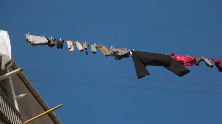 gürcü : Drying underwear after big wash, traditional Georgian home, neighborhood gossip Stok Video