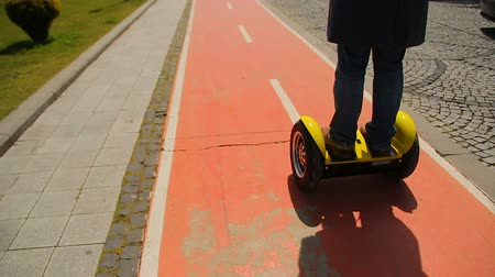 personal transporter : Man riding a segway, commuting to work, eco-friendly transport, modern vehicles