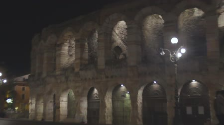 doorway : Verona Arena Roman amphitheater in Italy at night, ancient architecture, slow-mo Stock Footage