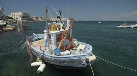 lifebuoy : Fishing boat floating on water, drift nets lying on deck, Ischia seascape