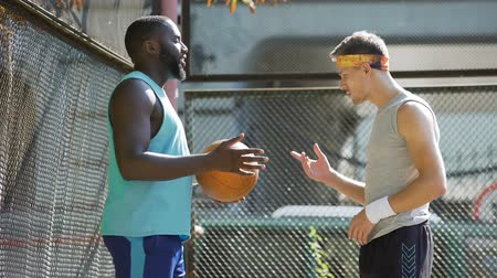 streetball : Trainer and basketball player talking about future game, active lifestyle Stock Footage
