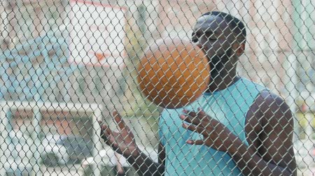 jailed : Jailed black man throwing ball under supervision, sports in prison, workout Stock Footage