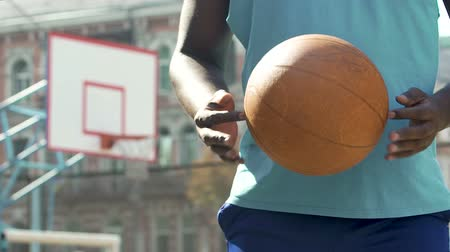 streetball : Professional basketball player holding ball, encouraging young people for sports