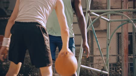 slintání : Multiracial men playing basketball having active rest after work, slow-motion Dostupné videozáznamy