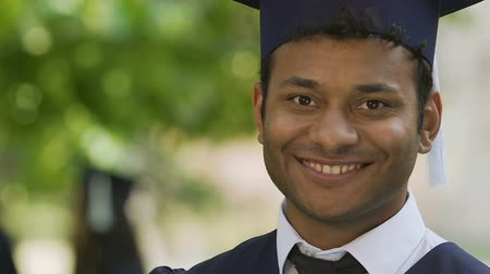 futuro : Happy biracial student showing international diploma, quality education system