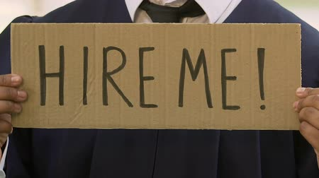 ma : Male student holding hire me sign, future career expectations, opportunities