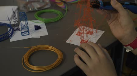 after school : Child using 3d pen, creating toy, diy activity with high tech device closeup