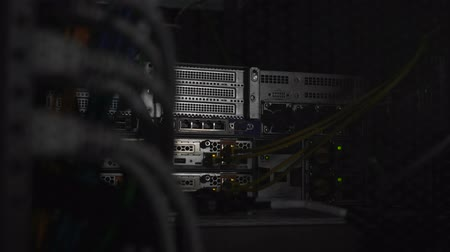 intruder : Working datacenter, illegal penetration into server room, flashlight and shadows Stock Footage