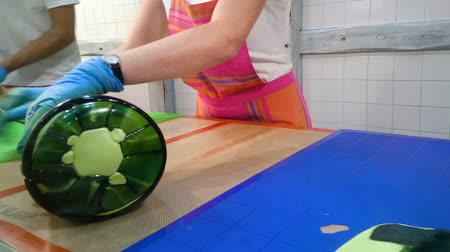 vidro : Manufacture of caramel candies, women rolling and glazing big piece of candy