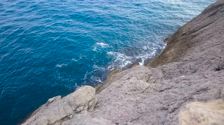 промывали : Calm sea waves gently washing the rough cliff, amazing nature and relaxation